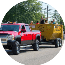 parade truck with roll ofdumpster